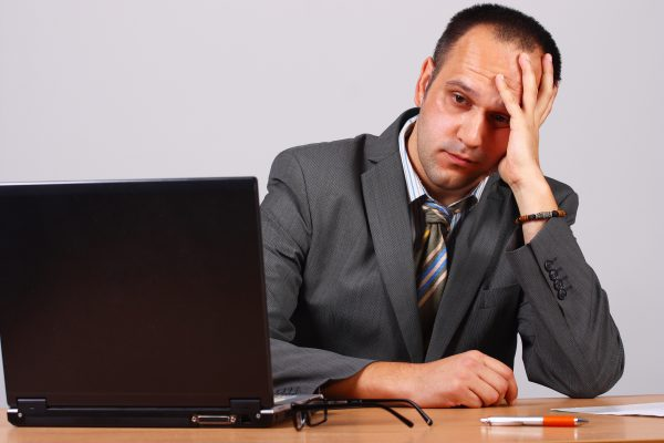 Worried businessman sitting in his office.